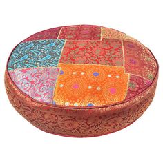 Round silk-blend brocade patchwork pillow.  Product: PillowConstruction Material: Cotton, silk, and polyester