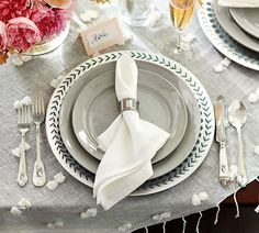 Classic gray dinnerware gets an upgrade with patterned chargers and table linens. Love the peonies, too!