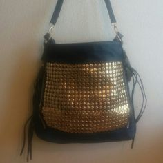 Edgy and pretty purse. Brand new with tags! Navy and gold studded purse. Comes with a shoulder strap and a long strap. Pretty floral interior, never been used. Zip zippers add edgy detailing. Luxcessories Inc Bags Shoulder Bags