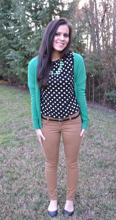 black and white polka dot top, tan/ khaki pants, green cardigan, teal necklace, black belt and shoes