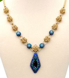 Regina - Rhinestone, Brass and Aluminum Necklace, via Etsy. by EclecticArtbyCynthia