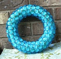 turquoise glass pebble wreath. I have made one like this in red but I am in love with this one