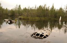 Portions of a submerged B-29 bomber in Alaska remain visible above water