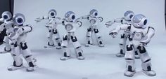 Robots Dancing to 'Thriller'. Choreographed through wi-fi allowing them to dance in sync. They can also play soccer.