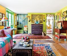 Kristin Nicholas is a designer and artist who lives on an insanely charming working sheep farm called Leyden Glen Farm. She shares the colorful home with her husband Mark, teenage daughter Julia, three dogs, five cats, chickens, and 400 sheep.