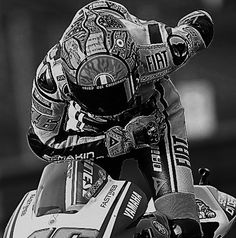 motorcycle driver bows on his bike after he win the track race