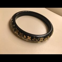 Louis Vuitton Bangle Love this bangle! I get so many compliments on it whenever I wear it. It has no scratches and in perfect condition. Authentic Louis Vuitton that has been discontinued so very rare to find. Louis Vuitton Jewelry Bracelets
