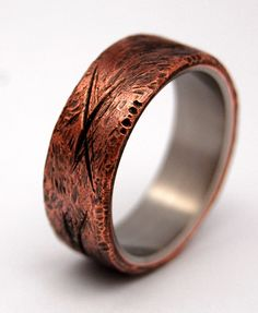 For the lover of all things rough and real. Gorgeous new commitment band! Hand beaten exterior copper over-layed on bright, shining titanium. Pictured at 7.9mm.