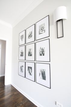 Symmetrical gallery wall in the hallway. This gallery wall makes such an impact with the black and white picture frames. wall A Feminine Home Tour in Chicago Black And White Picture Wall, White Picture Frames, Diy Picture Frames On The Wall, Black Frames On Wall, Picture Walls, Black And White Frames, Picture Matting, Black White, Collage Mural
