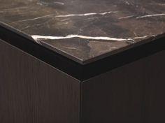 Exquisite dark marble kitchen top by Minotti. Brrr.