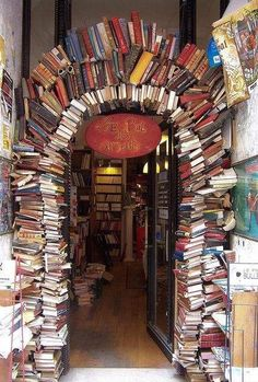 """This book arch is the entrance of a book store """"Le Bal des Ardents"""" in Lyon (Rue Neuve), France. (Picture via Breathing Books) - travel Studio Musical, Book Arch, Lyon France, Paris France, France Photos, Book Nooks, I Love Books, Belle Photo, Pretty Pictures"""