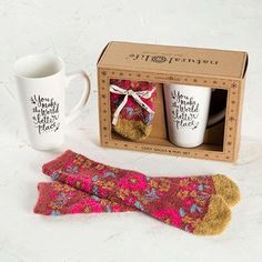 """Mug & Cozy Socks Gift Set - Give Cozy with our Mug & Sock Gift Set! It's the perfect way to help your loved ones feel warm, relaxed and comfy! The mug features a sweet """"You Make the World a Better Place"""" sentiment and the socks are made out of the comfiest material EVER!"""
