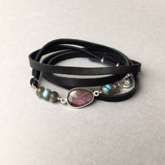 Purple Labradorite, accented with flashy blue grey Labradorite beads- a perfect solo leather wrap bracelet for everyday! ( $48) #labradoritejewelry #leatherbracelet #bohojewelry