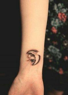 Wrist moon tattoo