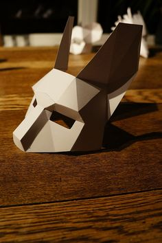 These plans and instructions enable you to make your own 3D Rabbit mask from cardboard. The instructions and templates are designed to be quick and easy to follow, so that the mask can be assembled by anyone, using local materials and removing the need for shipping. besides it's good fun turning a 2D material in to a 3D mask.