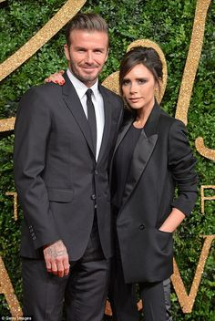 It's a wrap-around! In a rare display of random red-carpet affection, Victoria places an arm around David