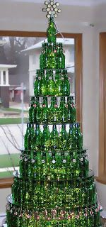 So Cool!! Green (beer?) Bottle Christmas Tree! Stack graduated glass circles with green bottles around each one. Put tinsel and/or lights inside each bottle - would look amazing all lit up! Not for people with pets or kids, though! ;)