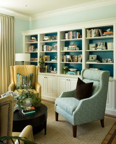 built in bookcases, painted blue back