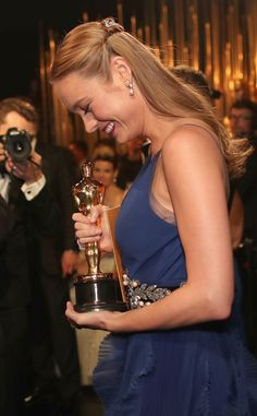 Brie Larson from The Big Picture: Today's Hot Pics  The Oscar winning actress hugs her statue after her win.