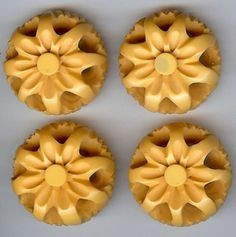 vintage bakelite flower buttons  (At first, I thought this was Cheez Whiz on Ritz! lol)