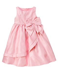 Our sumptuous duppioni dress is a perfect choice for special occasions. Elegant style features an oversized bow at the waist and draped overlay with rounded hem for dramatic detail. Full shirred skirt with a tulle-enhanced underlayer adds extra flounce. Fully lined for comfort. 100% polyester. Invisible back zipper for easy dressing. Lining with tulle underlayer. Approximately knee length. Machine washable. Imported. Collection Name: Blooming Nautical.
