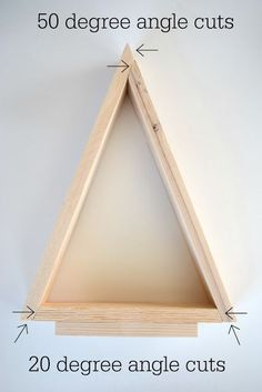 DIY Wooden Triangle Christmas Trees - - Build and adorable wooden Christmas tree to spruce up your holiday decor. It's an inexpensive DIY wood tree with a bit of a farmhouse look to it. Christmas Wood Crafts, Wooden Christmas Trees, Wooden Tree, Noel Christmas, Christmas Projects, Rustic Christmas, Christmas Tree Cut Out, Wooden Christmas Tree Decorations, Christmas Craft Fair
