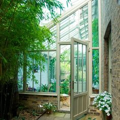 Would be cool to have a large lean to type greenhouse to have an all year round patio set. Lean To Conservatory, Conservatory Plants, Victorian Greenhouses, Country House Interior, Country Homes, Curved Pergola, Side Return, Glass Room, Patio Roof