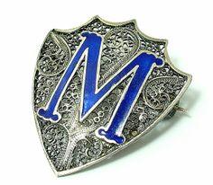 Antique/ estate, vintage Art Deco, 1920s/ 1930s, silver filigree and blue enamel, sheild M brooch/$50