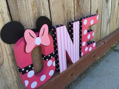A personal favorite from my Etsy shop https://www.etsy.com/listing/252428203/minnie-mouse-themed-one