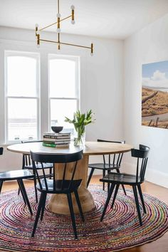 Designer Secrets: 14 Chic Ways to Trim Your Decorating Budget round rug dining room round table black farmhouse chairs brass modern chandelier southwest art print Dining Room Design, Dining Room Table, Dining Nook, Black Round Table, Circle Dining Table, Round Wooden Dining Table, Dining Sets, Wood Table, Kitchen Dining