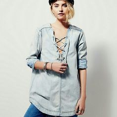Free People denim INDIGO LACE UP TUNIC FP Exclusive Only sold thru Free People Long sleeve denim tunic featuring lace-up detailing on the placket. Subtle high low, rounded hem. Roll the cuffs for a more casual, effortless look.   Color: Blue sky  Size Medium Free People Tops