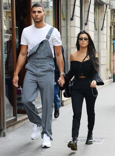 Kourtney Kardashian and Younes Bendjima Coordinate in Pinstripe Outfits in Paris | The eldest Kardashian and her 24-year-old boyfriend both wore pinstripes in Paris on Friday.