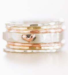 These almost-iridescent stacking rings with their subtle texture and delicate size makes them ia sweet reminder to love and be loved.