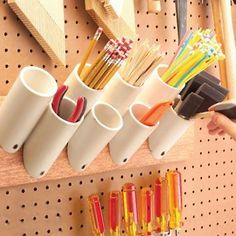 Use offcuts of PVC plumbing pipe in your workshop or craft room to store and organise your supplies and tools. Use a hacksaw or jigsaw to cut pipes at an angle and then mount these onto a piece of board - with screws driven in at an angle - to hang onto the wall.