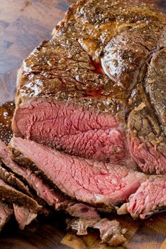Slow Cooker Roast Beef that you can slice into tender slices cooked to a perfect medium temperature. Enjoy for dinner or sliced thinly in sandwiches!