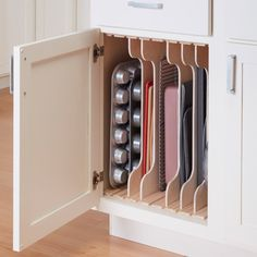 Kitchen Cabinet Organizers: DIY Dividers Adjustable slots organize cookware for space-efficient storage.