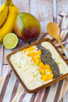 Filled with the flavors of the tropics, this tropical smoothie bowl will be your new favorite way to start the day. The flavors of the bananas, coconut and pineapple will transport you to somewhere warm and sunny. Get the recipe on http://RachelCooks.com!