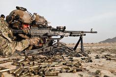 U.S Army Rangers firing an M-240 machine gun during advanced rifle marksmanship training in Kabul province on March 18, 2013.