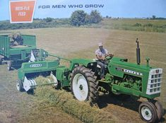 Oliver 520 baler, pulled by a 1650 tractor.