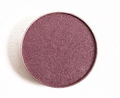 Makeup Geek Sensuous Eyeshadow in the shade twilight is a down-toned burgundy which is good for using in the outer 'v' of the eye, paired with a bronze on the lid and light pink to peachy lip colour.