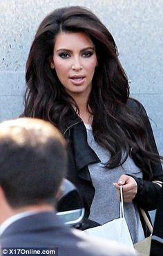 I personally think Kim Kardashian holds no relevance in this world, but I do like her hair style in this picture.
