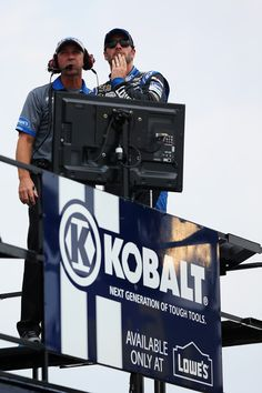 Jimmie Johnson, driver of the #48 Lowe's Dover White Chevrolet, looks on with his crew chief Chad Knaus from the top of his team hauler during practice for the NASCAR Sprint Cup Series AdvoCare 500 at Atlanta Motor Speedway on August 30, 2013 in Hampton, Georgia.