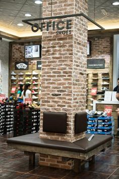 Office shoes hanging sign around brick column interior columns, columns decor, brick columns, Columns Decor, Brick Columns, Interior Columns, Brick Walls, Store Signage, Wayfinding Signage, Signage Design, Office Signage, Office Seating