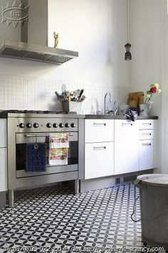 euro-style kitchen // spanish inspired tile floor