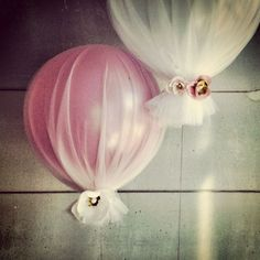 Balloon + tulle.-great way to keep it classy but add something extra to decorate and use space