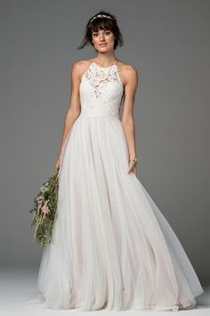 Feminine and sweet, this gown featuring Anemone Embroidered Lace and Illusion Tulle is a perfect match for the bride who craves a hint of whimsy on her big day. An eye-catching halter bodice cascades into a skirt of Soft Netting, creating an ethereal spirit. Sweep train. #weddingdress #watters #willowby