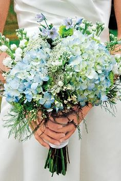 Bouquet with blue hydrangeas- I like the wildflower look with the touch of class by the hydrangeas. BEAUTIFUL! Light blue and greens are pretty 2gether