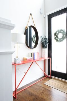 Blu Dot's Strut table makes for a modern entrance to their home.