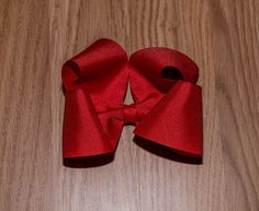 Red hair bow- hair bow- 4 inch bow- toddler hair bows- large boutique bow- boutique hair bow- toddler hair clip- hair clip by NanabellesPretties on Etsy https://www.etsy.com/listing/503936233/red-hair-bow-hair-bow-4-inch-bow-toddler
