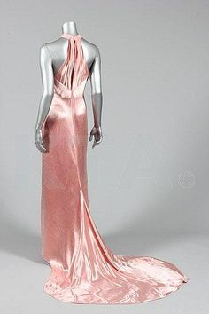 ~A pink satin-backed crêpe couture gown in the style of Lanvin, circa 1934, but bearing Mamie, Edinburgh retail label, with contrasting matt centre front panel and collar, shirring to neck, with centre-back opening and ties, long, trained skirt with finger loop~